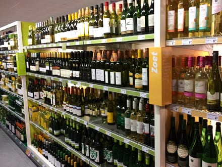 Supermarket shelves ranging wine by flavour profile